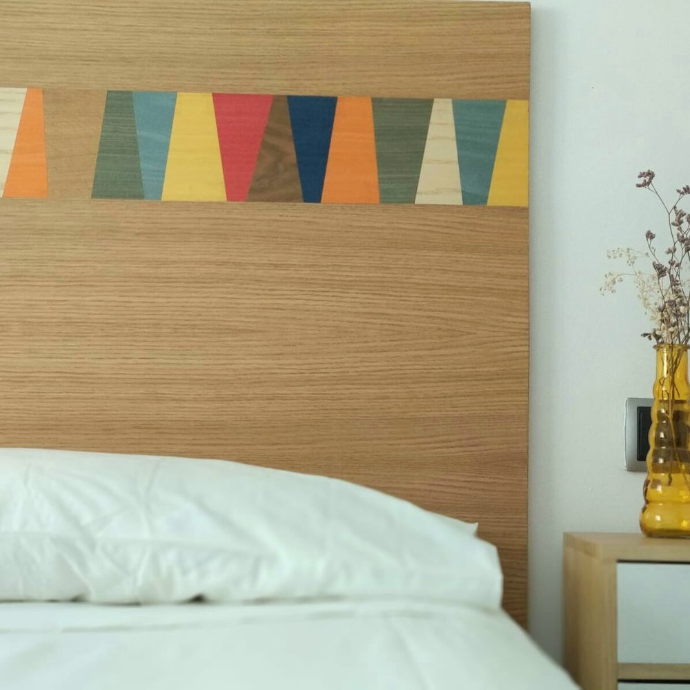 Design of a bed head and matching bedside tables