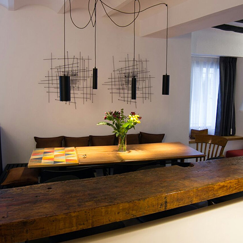 Table annex with geometric marquetry design