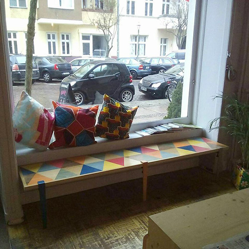 Bench with geometric marquetry