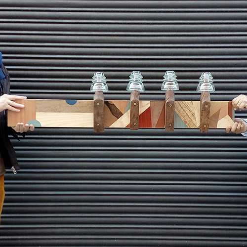 Artistic coat rack with geometric marquetry
